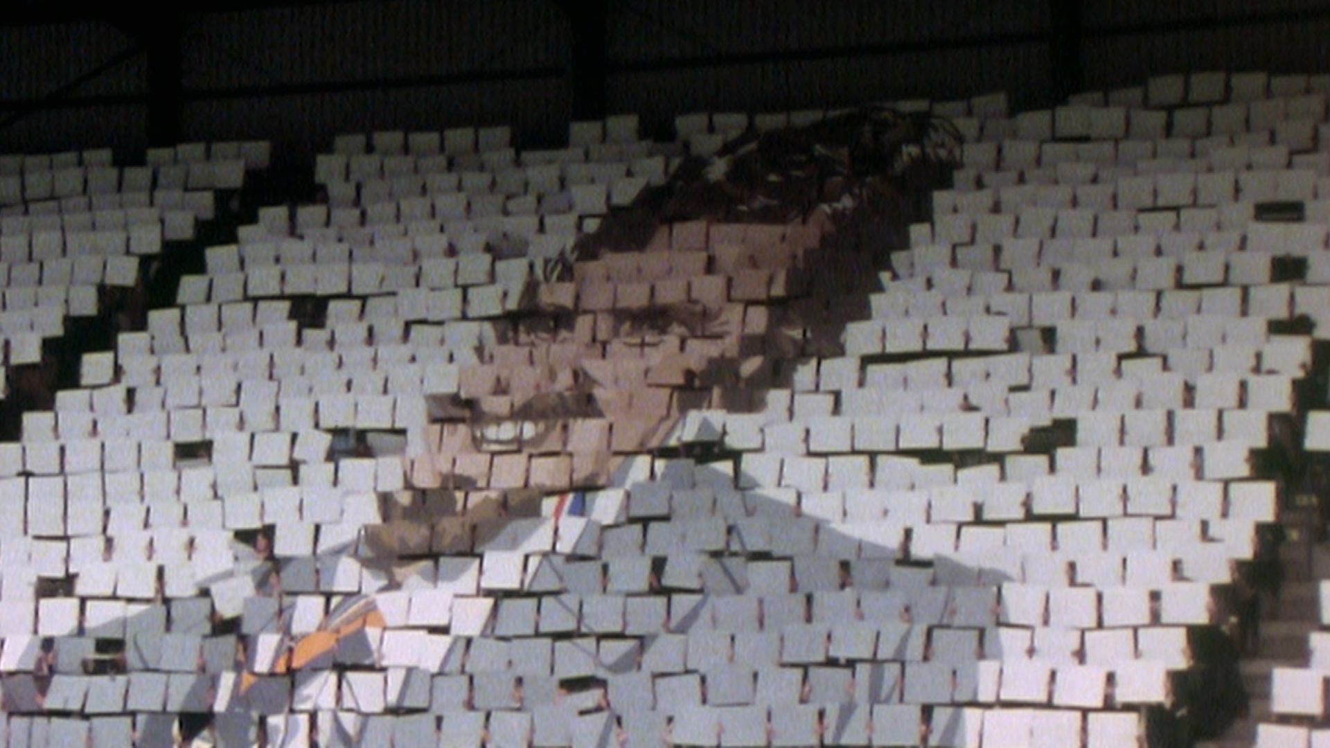 Jimmy Hill: A Man For All The Seasons - Football fans hold up image of Jimmy at game