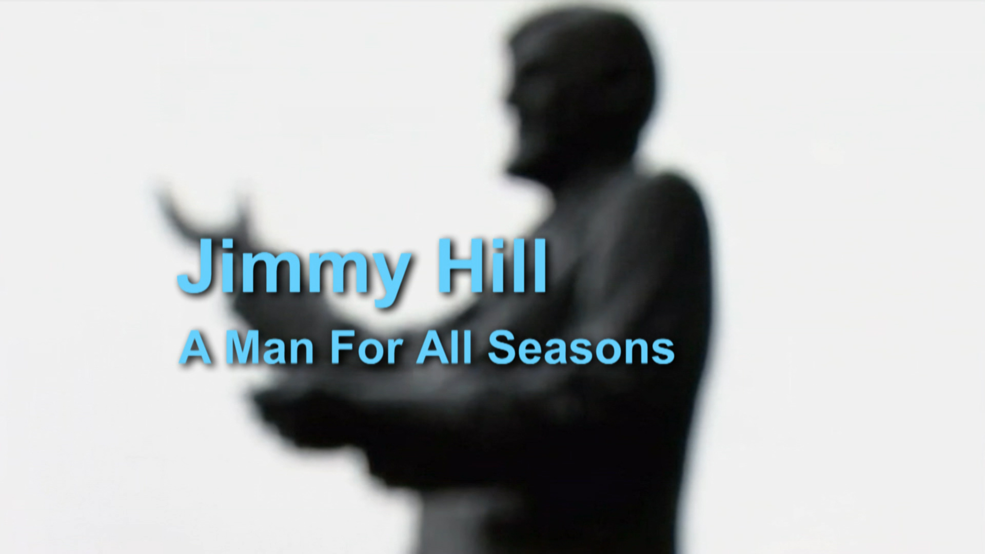 Jimmy Hill: A Man For All The Seasons - title card with backdrop of Jimmy Hill statue