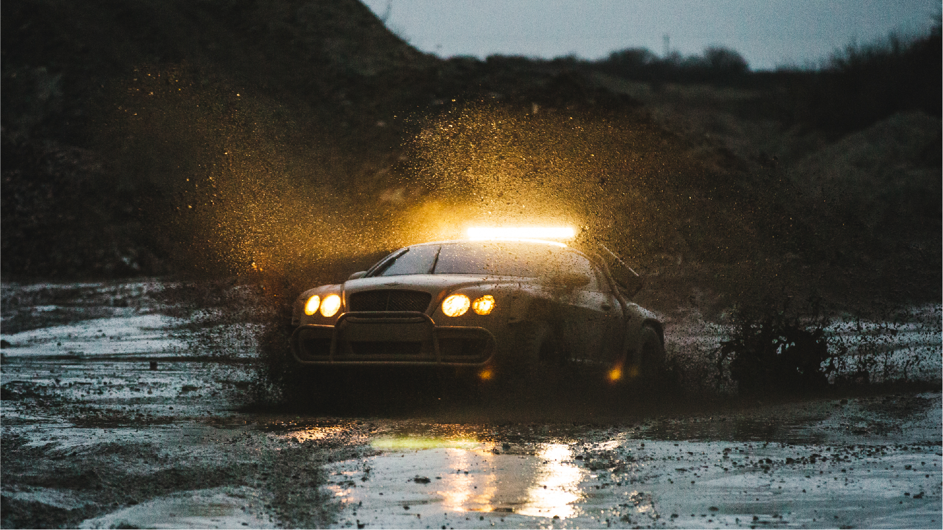 supercar megabuild - bentley supercar driving through mud