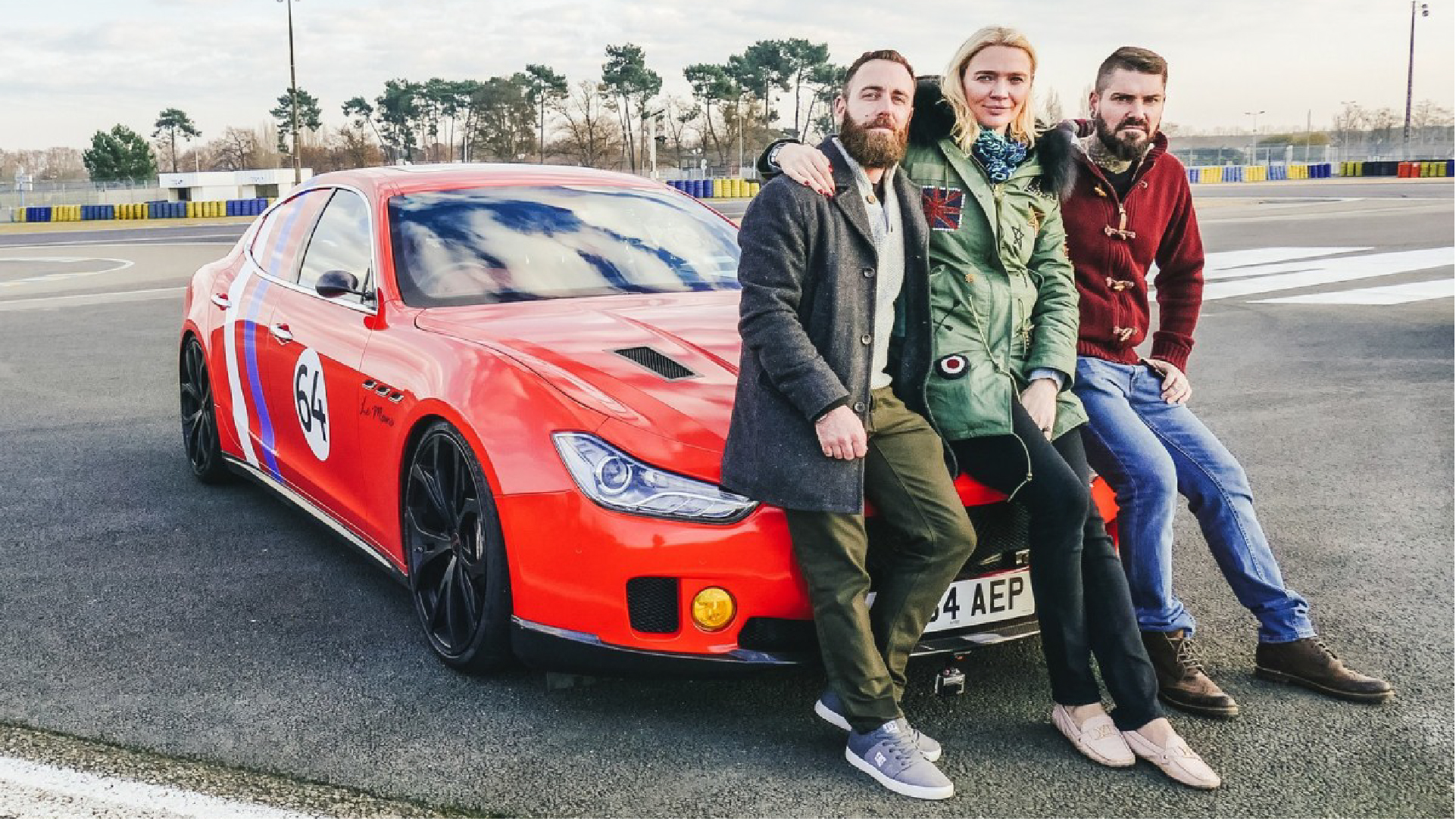 supercar megabuild - shane, jodie and dan sat on the front of red maserati car