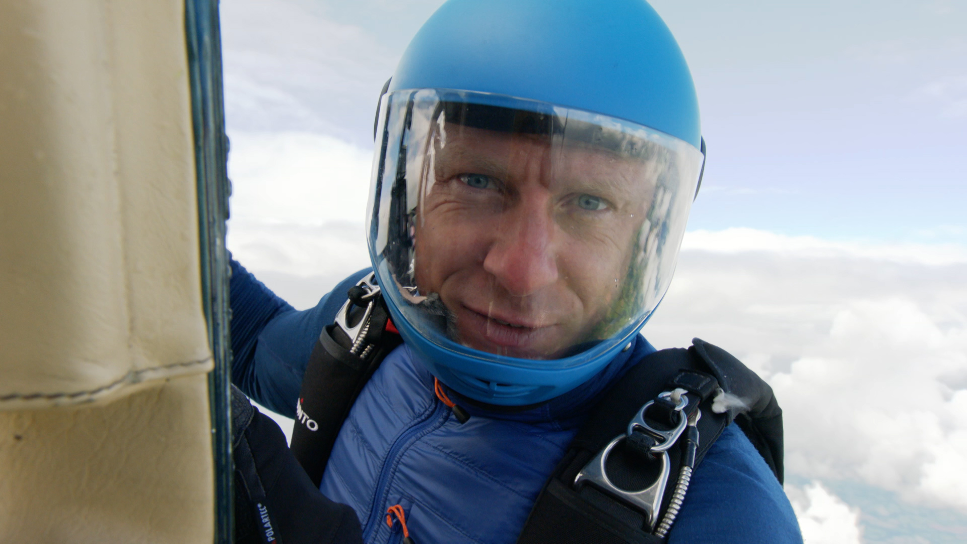 CBBC Beyond Bionic - Andy Torbet hanging onto the side of a plane