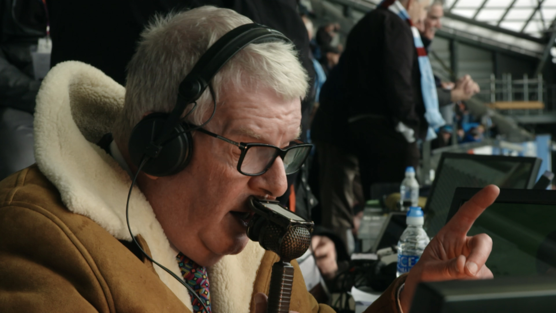 Motty: the man behind the sheepskin - Motson commentating with sheepskin jacket