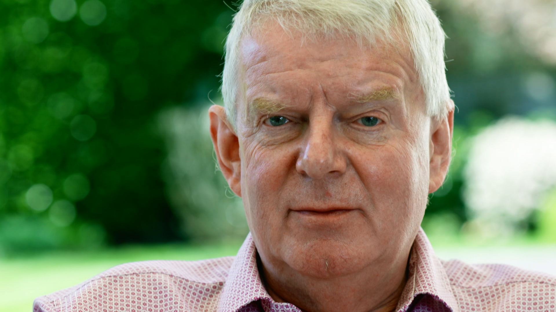 Motty: the man behind the sheepskin - John Motson looking into camera
