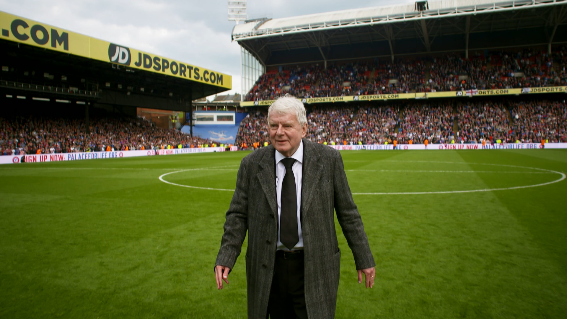 Motty: the man behind the sheepskin - John Motson on the pitch at Selhurst Park