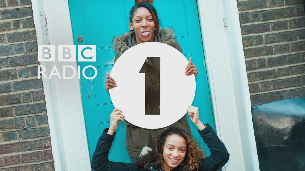BBC Radio 1 logo with two kids holding the logo